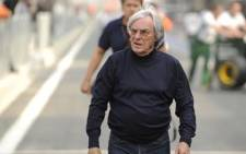 Formula One Group CEO Bernie Ecclestone walks down the pit lane at Formula One's Korean Grand Prix circuit in Yeongam on October 21, 2010. Picture: AFP.