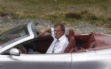 In this file picture taken on September 24, 2009, British television BBC presenter of motor show 'Top Gear' Jeremy Clarkson is pictured driving an Aston Martin, 300 km northwest from Bucharest. Picture: AFP.