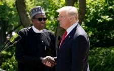 US President Donald Trump and Nigeria's President Muhammadu Buhari shake hands as they take part in a joint press conference in the Rose Garden of the White House on 30 April, 2018 in Washington, DC. Picture: AFP.