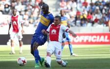 Mpho Matsi of Cape Town City and Ndiviwe Mdabuka of Ajax Cape Town fight fort he ball. Photo: Bertram Malgas