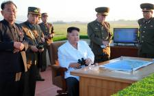 FILE: North Korean leader Kim Jong-Un conducts a weapons inspection. Picture: AFP