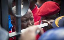 EFF leader Julius Malema negotiates with police to open the gates to the Union Buildings in Pretoria. Picture: Thomas Holder/EWN
