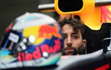 FILE: Red Bull's Australian driver Daniel Ricciardo is pictured in the pits during the Formula One Mexico Grand Prix second practice session at the Hermanos Rodriguez circuit in Mexico City on 27 October 2017. Picture: AFP.