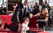 Actor Dwayne Johnson, Jasmine Johnson and singer Lauren Hashian attend a ceremony honouring Johnson with the 2,624th star on the Hollywood Walk of Fame on December 13, 2017 in Hollywood, California. Picture: AFP