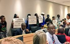 Black First Land First members disturb meeting by raising banners supporting Public Protector Busisiwe Mkhwebane. Picture: Babalo Ndenze/EWN.