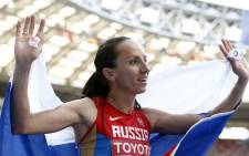 Russia's Mariya Savinova celebrates after winning silver during the women's 800 metres final at the 2013 IAAF World Championships at the Luzhniki stadium in Moscow on 18 August 2013. Picture: AFP