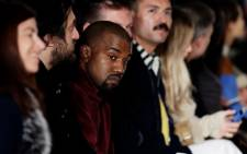 US rapper Kanye West (centre) attends the presentation of the Fall 2015 collection by US designer Jeremy Scott. Picture: EPA/JASON SZENES