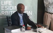 State witness Levy Mosenogi, the Gauteng Health Department Chief Director of planning, policy and research, testifies during the Life Esidimeni arbitration process. Picture: Masego Rahlaga/EWN