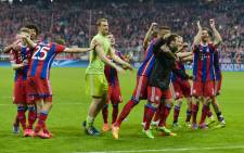 Bayern Munich's players celebrate after the UEFA Champions League second-leg quarter-final football match Bayern Munich v FC Porto in Munich, southern Germany on 21 April, 2015. Picture: AFP.