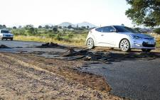 Cars pass over a strip of torn-up of tarmac in Vuwani, Limpopo. Picture: Pelane Phakgadi/EWN