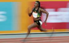 FILE: Jamaica's Elaine Thompson competes in the athletics women's 200m semi-final during the 2018 Gold Coast Commonwealth Games at the Carrara Stadium on the Gold Coast on 11 April 2018. Picture: AFP