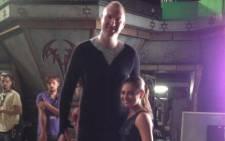 Neil Fingleton with Mila Kunis on the set of Jupiter Ascending. Picture: @NeilFingleton/Twitter.