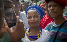 "DA spokesperson Phumzile van Damme poses for a picture with a protestor at the ""Day of Action"" march against the leadership of President Jacob Zuma held in Pretoria on 12 April 2017. Picture: Reinart Toerien/EWN"