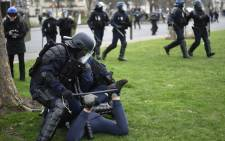 Riot police forces arrest a young man following clashes between demonstrators and riot-police during a protest of students against police brutality, following the alleged rape of Theo in Paris, on February 23, 2017. Picture: AFP.