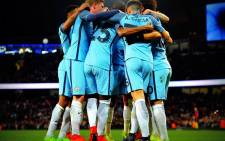 Manchester City players in a huddle. Picture: @ManCity/Twitter