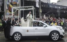 Pope Francis waves from the Popemobile on his way to the Enrique Olaya Herrera airport, in Medellin, Colombia, on 9 September, 2017. Picture: AFP.