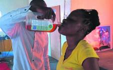 FILE: A screengrab showing Prophet Rufus Phala giving one of his church members Dettol. Picture: Facebook.com..