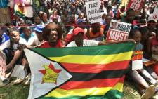 Crowds of Zimbabweans gather at the African Unity Square opposite Parliament on 21 November 2017 as they await impeachment proceeding against Robert Mugabe. Picture: EWN