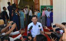 Myanmars Commander-in-Chief Min Aung Hlaing talking to journalists after casting his ballot at a polling center in Naypyidaw on 8 November, 2015. Myanmars powerful army chief on 11 November, 2015 congratulated Aung San Suu Kyis party for winning a majority in landmark polls, agreeing to talks as her pro-democracy opposition appeared set for a landslide victory. Picture: AFP.