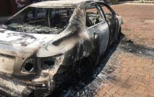 Two cars used by Uber drivers have been torched and Foton offices vandalised by metered taxi drivers near the OR Tambo International Airport. Picture: Mia Lindeque/EWN.