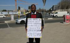 FILE: Thembinkosi Pakithi is a Public Relations graduate seeking employment by putting himslef out there standing on a street corner. Picture Phumlani Pikoli/EWN