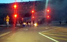 Protesters barricade a road with burning tyres in Atteridgeville on 24 Fberuary 2017. Picture: @ChabaneTT