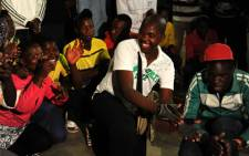 Supporters of expelled ANC Youth League president Julius Malema hold a night vigil at the Nirvana community hall in Polokwane in Limpopo on Tuesday, 25 September 2012 ahead of his court appearance. Picture: Werner Beukes/SAPA.