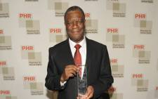 Founder of Panzi Hospital, Dr. Denis Mukwege is posing with his award for fearless advocacy to end the terror of rape in conflict and his devotion to caring for survivors in the Democratic Republic of the Congo as he attends the 2015 Physicians For Human Rights Gala at Jazz at Lincoln Centers Frederick P. Picture: AFP.