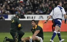 Springbok lock Eben Etzebeth receives treatment on the field. Picture: AFP