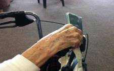 FILE: An elderly resident from the Cape Peninsula Organisation for the Aged holds her ID before casting her special vote on 17 May 2011. Picture: EWN
