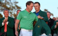 Jordan Spieth of the United States presents Danny Willett of England with the green jacket after Willett won the 2016 Masters Tournament at Augusta National Golf Club on 10 April, 2016 in Augusta, Georgia. Picture: AFP.