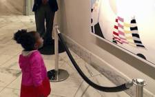 A screengrab of Parker Curry (2) awestruck by a portrait of former US first lady, Michelle Obama. Picture: CNN