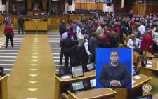 FILE. A screengrab of members of parliamentary protection services removing EFF leader Julius Malema from the National Assembly on 9 September 2015 after he refused to withdraw his comment that deputy president Cyril Ramaphosa was a murderer.