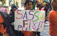 FILE: Several protesters are gathered outside St George's Cathedral in Cape Town on Thursday 15 October 2015. They are calling for action, claiming they have been short changed by grants administrator Cash Payment Services. Picture: Natalie Malgas/EWN.