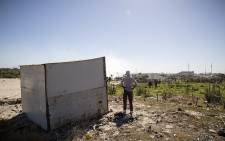 A man stands next to his newly completed shack in what settlers named 'Azania', the area of land they invaded next to the Nolungile Station in Khayelitsha. Picture: Thomas Holder/EWN