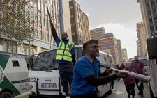 Hundreds of security officers are marching to the Gauteng provincial Community Safety MEC's office in Johannesburg CBD on 12 June 2018. Picture: Sethembiso Zulu/EWN