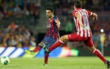 Barcelona midfielder Xavi playing against Atletico Madrid earlier this season. Picture: Facebook.com