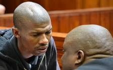 Anni Dewani's killer, Xolile Mngeni, speaks to his lawyer in the Western Cape High Court on 26 November 2012 during his sentencing proceedings. Picture: Aletta Gardner/EWN