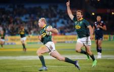 FILE: Springbok scrumhalf Ross Cronje runs in to score a try. Picture: AFP