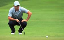 Rory McIlroy of Northern Ireland lines up a putt for eagle on the 18th green during the second round of the 96th PGA Championship at Valhalla Golf Club on 8 August 2014. Picture: AFP.