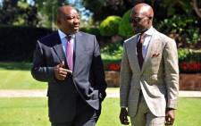 FILE: Deputy President Cyril Ramaphosa (left) has a discussion with Finance Minister Malusi Gigaba. Picture: Twitter/@MTshwete.