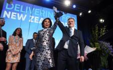 Leader of the National Party Bill English (R) and his wife Mary (L) react onstage at the party's election event at SkyCity Convention Centre in Auckland on 23 September 2017. New Zealanders went to the polls on 23 September to elect a new parliament. Picture: AFP.