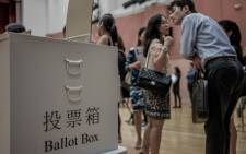 A ballot box is seen displayed at a mock polling station set up to help electors familiarise themselves with voting procedures in Hong Kong on September 6, 2012. Hong Kong goes to the polls Sunday to elect a new legislature that will lay the ground rules for direct elections, amid growing disquiet over mainland China's hold over the former British colony. Picture: AFP.