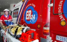 ER24 paramedics attend to a patient. Picture: Supplied