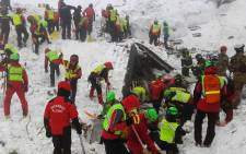 A handout picture released on January 21, 2017 by the Corpo Nazionale Soccorso Alpino e Speleologico (CNSAS) shows a rescuers digging at the avalanche-hit Hotel Rigopiano, near the village of Farindola, on the eastern lower slopes of the Gran Sasso mountain. Italian rescuers pulled four survivors from the hotel and said they remained hopeful of finding alive at least some of the 23 people still trapped under the ruins. Picture: CNSAS/AFP.