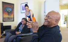 Archbishop Desmond Tutu with members of staff at the offices of the Desmond and Leah Tutu Legacy Foundation on 24 April, 2013. Picture: Desmond and Leah Tutu Legacy Foundation by Oryx Media