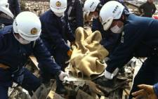 A body is recovered in Natori near Sendai, Japan. Picture: Alex Eliseev/Eyewitness News