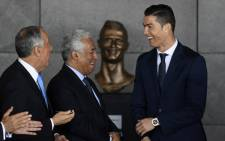 Portuguese footballer Cristiano Ronaldo (R), Portuguese Prime Minister Antonio Costa and Portuguese President Marcelo Rebelo de Sousa take part in a ceremony where Madeira's airport in Funchal will be renamed after Cristiano Ronaldo, on Madeira island, on 29 March, 2017. Picture: AFP.