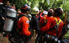 Thai rescue personnel arrive at the Tham Luang cave to conduct operations to find the missing members of the children's football team in a cave chamber along with their coach at the cave in Khun Nam Nang Non Forest Park in Chiang Rai on 25 June 