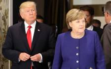 US President Donald Trump and German Chancellor Angela Merkel arrive for a bilateral meeting on the eve of the G20 summit in Hamburg, northern Germany, on 6 July 2017. Picture: AFP.